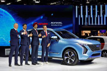 Phil Simmons, Kaushik Ganguly, Harpreet Singh Brar and Ramon Ginah pose for a picture after unveiling the Haval Concept H at the India Auto Expo 2020 in Greater Noida
