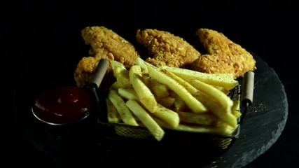 Fototapete - Breaded crispy fried chicken wing, french fries,  rotation 360 degrees.