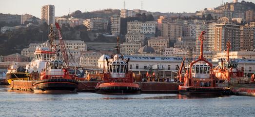 GENOA, ITALY, JANUARY 23, 2020 - Tugboats moored in the port of Genoa, Italy