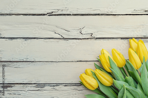 Springtime flowers. Colorful tulips on rustic wooden background. Springtime, Mother's day, Valentine's Day, Easter concept.