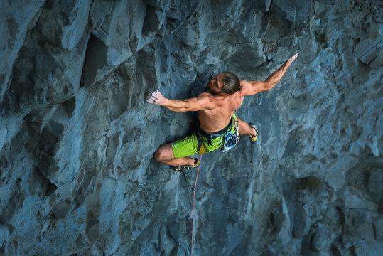 Powerful sportive rock climber