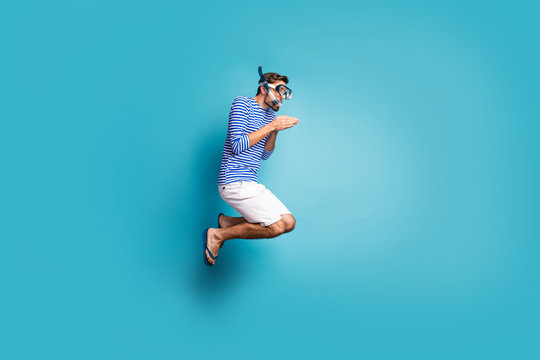 Full size profile photo of funky crazy guy tourist jump high swimming deep water mask tube diving wear striped sailor shirt vest shorts flip flops isolated blue color background