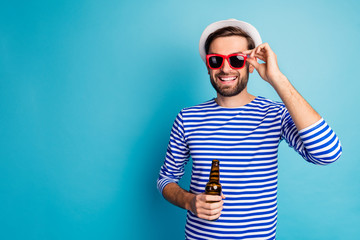 Photo of nice traveler guy drink beer bottle all inclusive exotic resort good mood summer holidays...