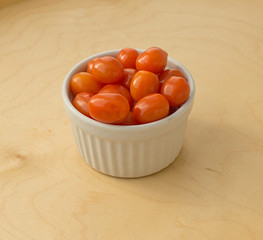 Isolated cherry tomatoes on a wooden background