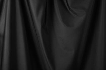 Black luxury fabric background, drapery texture