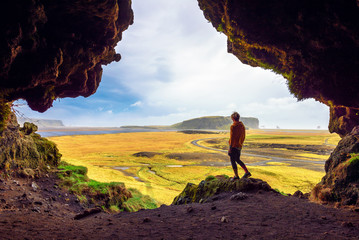 Hiker in the Loftsalahellir Cave near the village of Vik in Iceland