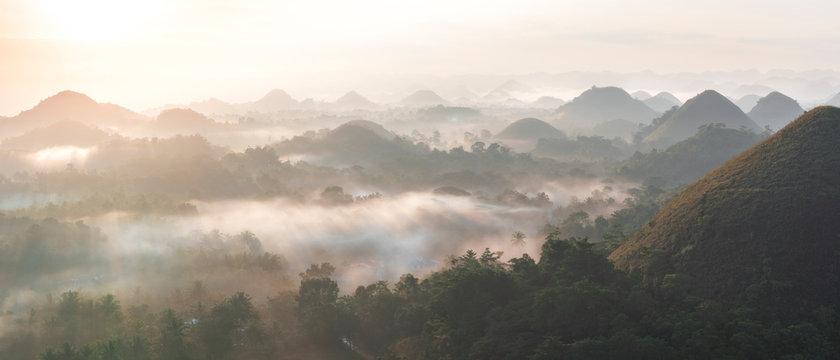 Panorama view of chocolate hills in Bohol, philippines at sunrise, mist fog, carmen, Asia