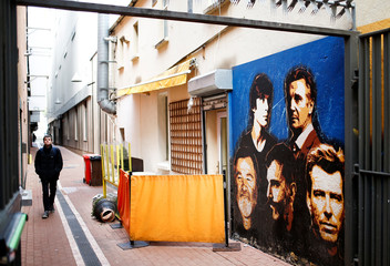 A mural displaying pictures of Irish celebrities is seen in the city centre during the build-up to Ireland's national election, in Cork