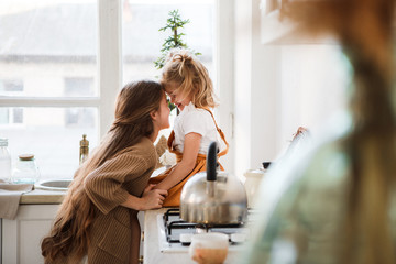 Two sisters play in a bright, stylish kitchen. Beautiful interior. Wall mural
