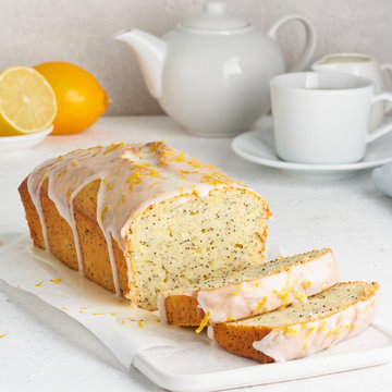 Lemon bread coated with sugar sweet icing and sprinkled with lemon peel. Slice of cake with citrus