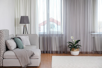 Window with stylish curtains in living room interior Fotobehang