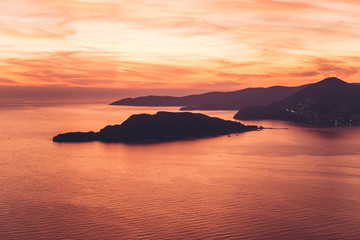 Foto auf AluDibond Koralle Beautiful view of the sunset and the natural landscape with the sea and hills or mountains in Montenegro.