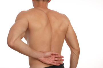 Man suffering from back pain. Muscle spasm . Chiropractic concept. Sport exercising injury