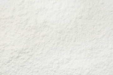 Pile of organic flour as background, top view