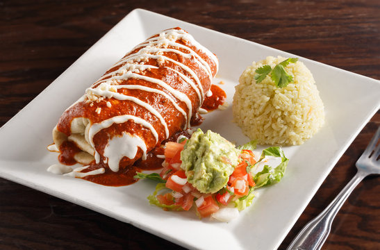 Mexican Carne Asada Burrito Served with Rice and Guacamole