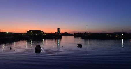 Victoria and Albert piers, Jersey, U.K. Winter sunset getting lighter evenings.