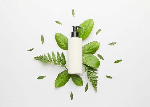 Cosmetic product in bottle on white background