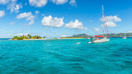Turquoise sea and anchored yachts near Carriacou island, Grenada, Caribbean sea