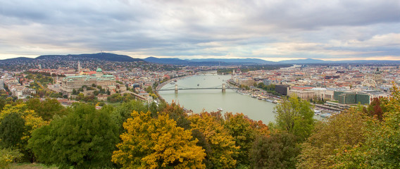 Panoramic view from Gellert Hill on landmarks of Budapest at autumn sunset, Hungary