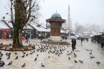 Sarajevo, Bascarsija, city centre at winter day. Old town quarter and Sebilj fountain. Tourist destination and famous landmark. The capital of Bosnia and Herzegovina. Ottoman architecture.