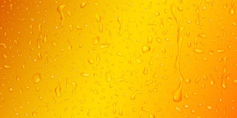 Background with drops and streaks of water in yellow colors, flowing down the surface
