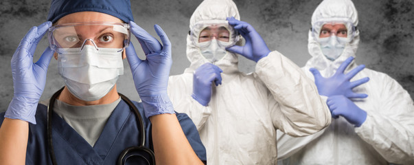 Caucasian Woman, Man and Chinese Man In Masks, Goggles and Hazmat Suites