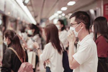 Middle aged Asian man wearing glasses and medical face mask,  Wuhan coronavirus covid-19 outbreak, air pollution and health concept