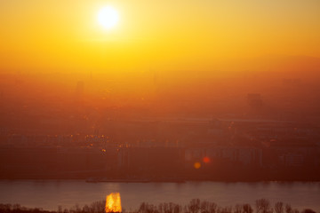 Foto op Canvas Rood traf. landscape of Vienna in the foggy evening with fantastic sunset