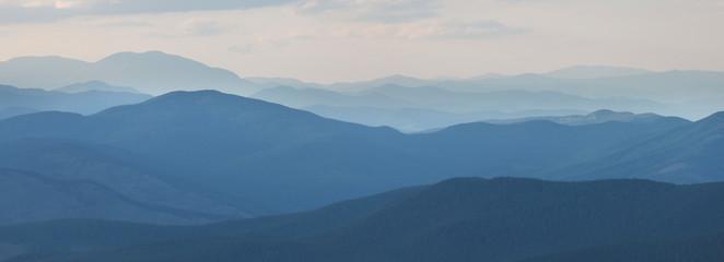 Evening haze in the mountains, sunset light