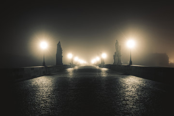 View of the Charles Bridge in Prague on Misty Night