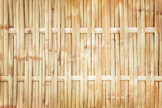 old grungy thai handcraft of bamboo weave pattern fence texture background