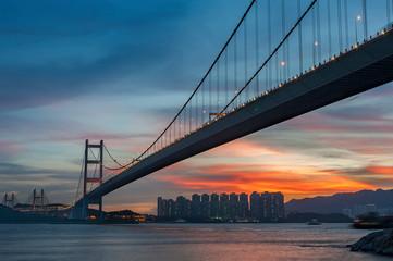 Fototapete - Tsing Ma bridge in Hiong Kong under sunset