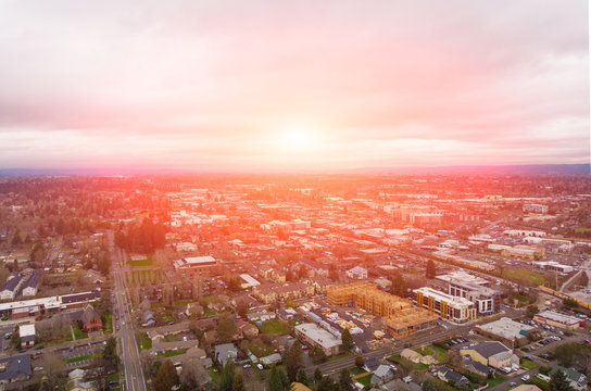 A photo of Beaverton, Oregon, USA, at sunset, a suburb. A photo from a height at sunset or sunrise. Design background