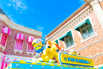 """OSAKA, JAPAN - AUGUST 12, 2019: """"HAPPY MINION CART"""" shop, selling Pop corn, located in Universal Studios JAPAN (USJ). Minions are famous characters from Despicable Me animation."""