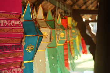 Colorful fabric mobile pendent northern Thai style hanging in the temple for good luck