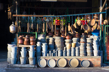 traditional kitchen utensils made from clay pottery and stone