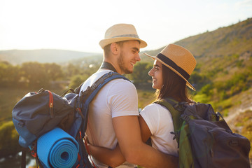 Romantic couple hikkers with backpacks on hikking the nature. Fotomurales