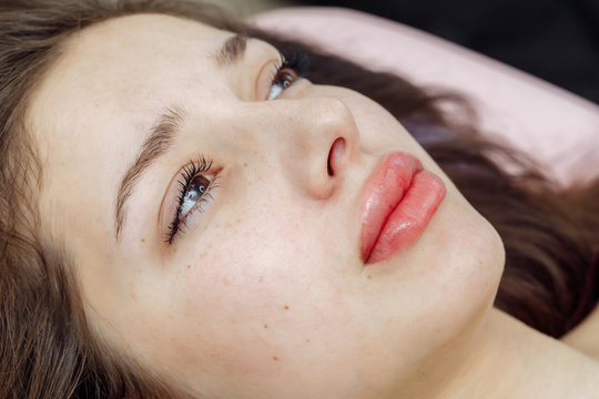 Lips after permanent makeup in beauty salon