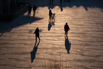 CityLife Business, Shopping and residential area in Milan, Italy. People walking in backlight.