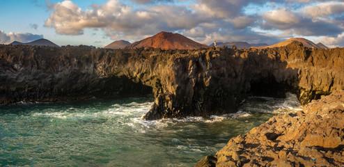 Foto op Aluminium Khaki Beautiful sunset over the rocky coast of Lanzarote near Los Hervideros