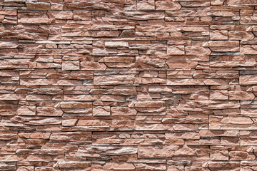 Brown brick wall or stone wall texture and background