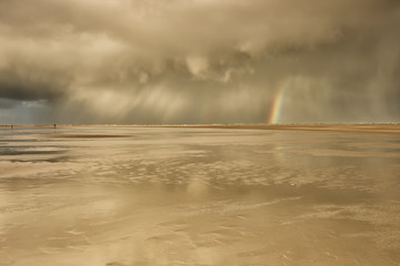 dramatic storm shower cloud and rainbow