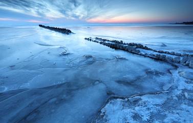 frozen big lake in winter at dusk