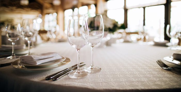 Eleant table setting, glasses on table in restaurant