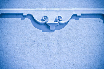 Classical plaster frame against a wall - concept image