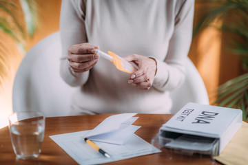 Senior Woman Preparing DNA Genetic Test Kit