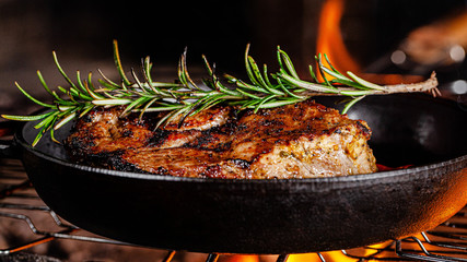 Turkish cuisine. Lamb steak is fried on a fire in a cast iron pan. background image, copy space text