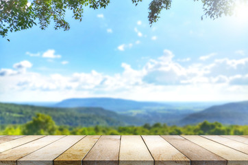 Wooden table against mountain, hill, blurry background.