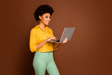 Profile photo of beautiful dark skin wavy lady holding notebook hands searching corporate...