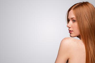Attractive ginger female with freckled shoulder